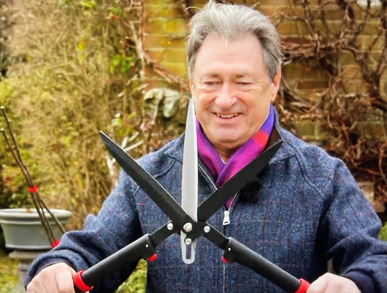 Alan Titchmarsh holding a pair of Darlac TriBlade Garden Shears